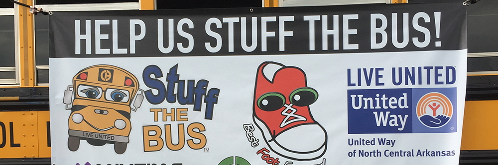 "banner reading ""help us stuff the bus"""